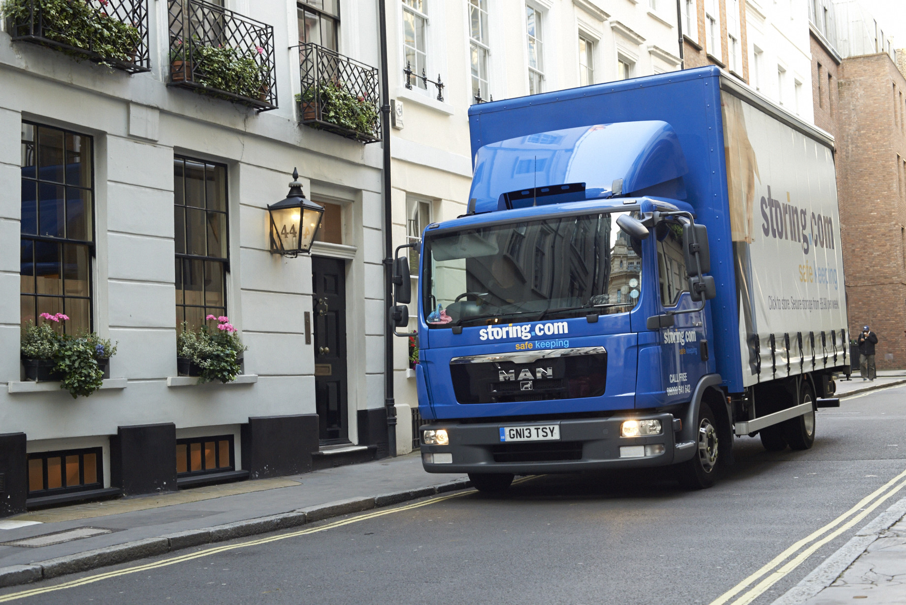 truck london outside victorian house